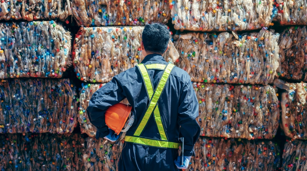 worker at a plastic waste recycling site