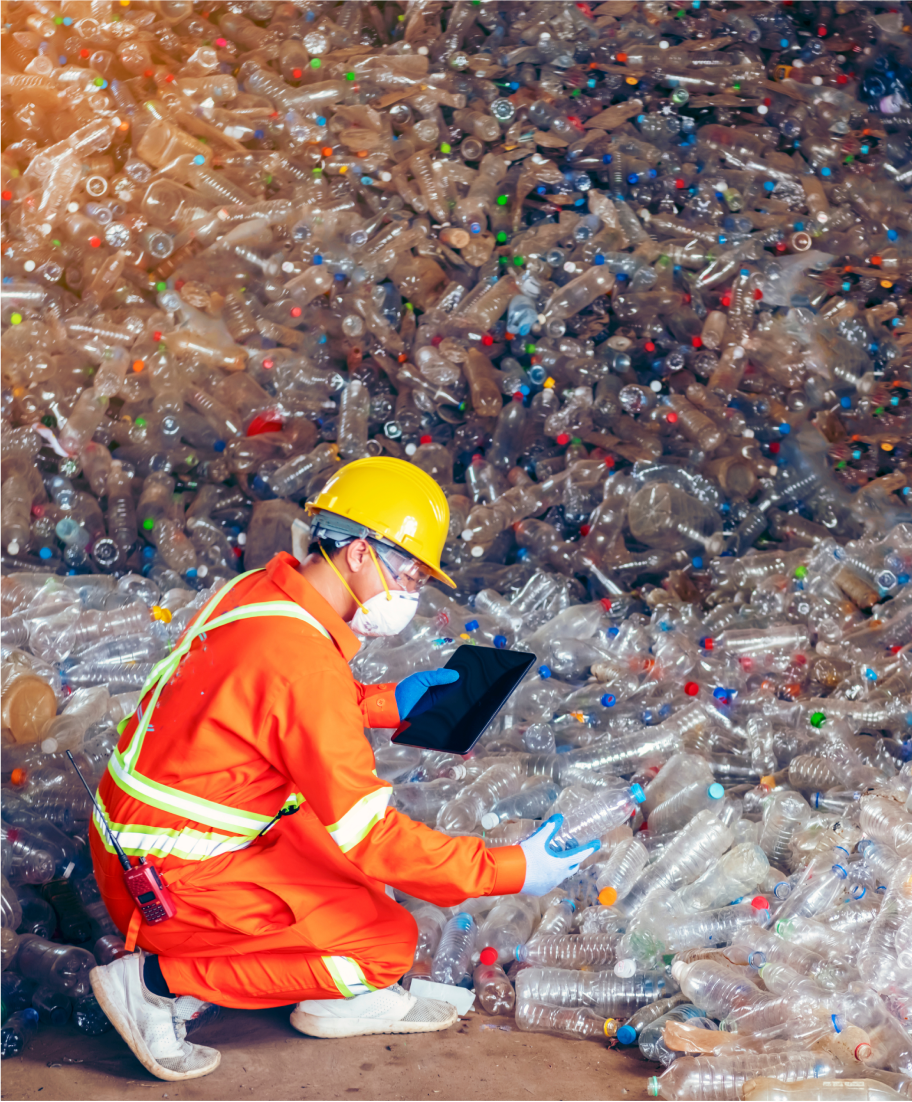 worker at a plastic waste collection site